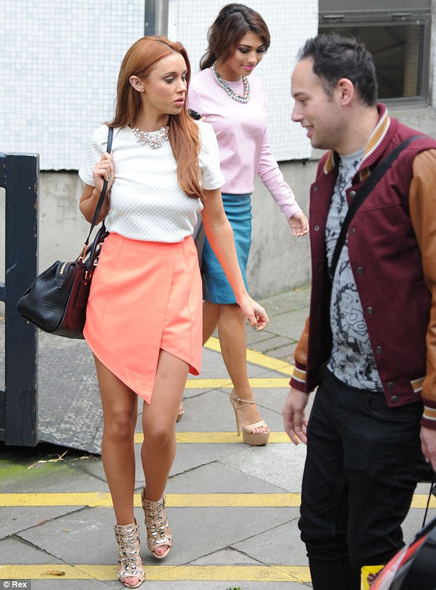 Awesome in angles: Una Healy opted for an orange skirt with an uneven hemline, teamed with a plain white top