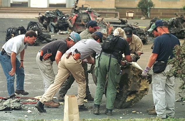 FBI agents look for evidence through the U.S. Embassy in Nairobi debris.