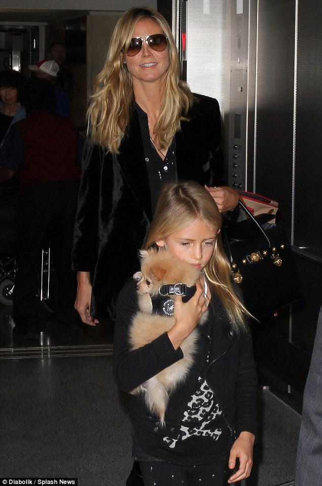 Blondes in black: Model Heidi Klum and daughter, Leni - who just got a new puppy - arrived back to Los Angeles Sunday after attending Kid's Fashion Week in New York