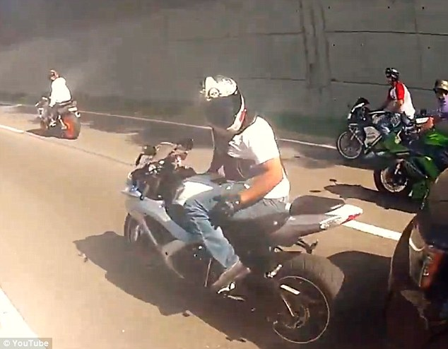 Beginning of the end: But then Alexian Lien's SUV taps the rear wheel of this motorcycle