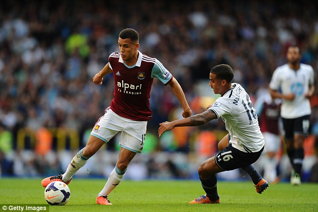 Full charge: Morrison on another forward run during the 3-0 win at White Hart Lane, leaving Kyle Naughton for dead
