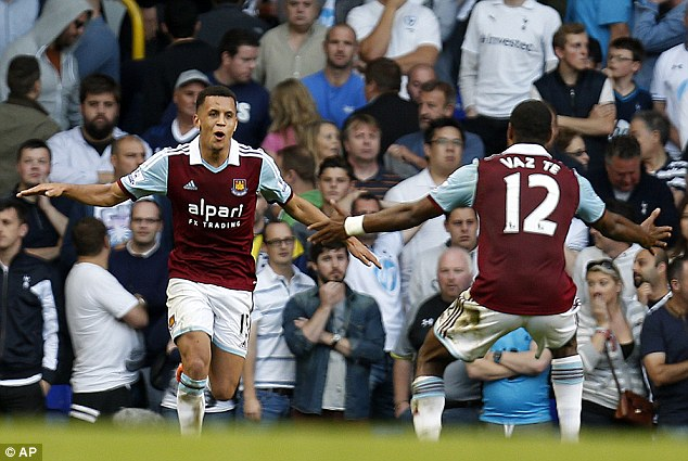 That was special: West Ham's Ravel Morrison celebrates with Ricardo Vaz Te after his spectacular solo run and goal set the seal on his team's 3-0 win at Tottenham