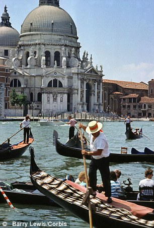 Sign of the times: Gondoliers are soon to be fitted with GPS systems to monitor the speed and position of boats in the wake of calls to better regulate Venice's waterways