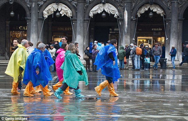 Dampener: The bad weather and unseasonably early acqua alta may have put a dampener on those hoping to grab a late summer romantic break