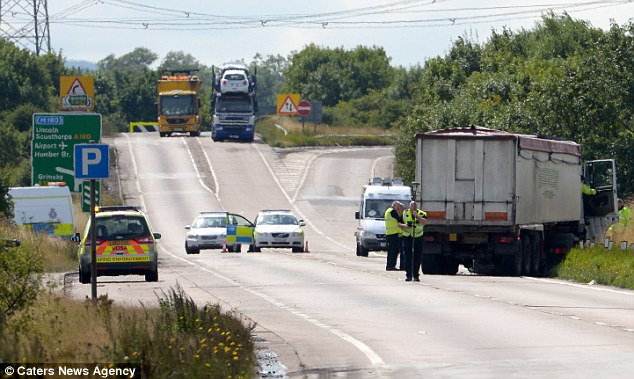 Crash scene: Mr Mitchell, 30, was driving to meet Miss Hoyle's father Patrick when the head-on accident happened on the A160 in Grimsby