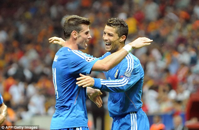 All smiles: Bale and Ronaldo celebrate a Madrid goal against Galatasaray in the Champions League