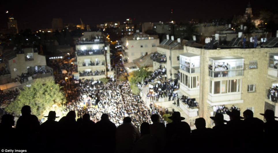 The crowds stayed in the streets long into the evening as Shas leader cried: 'What will become of us?'