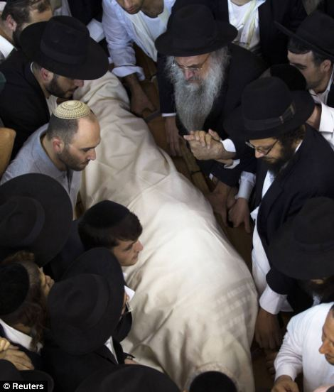 Thousands of police officers tried to control the 600,000 people lifting Yosef's body through the crowds