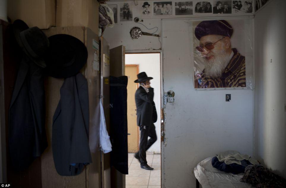 Worshipped: A portrait of Rabbi Ovadia Yosef hangs on a wall in a yeshiva