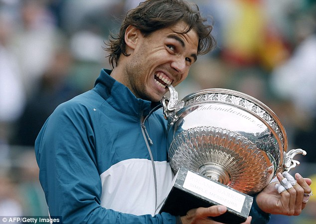 Glory: Nadal also won the French Open for the eighth time