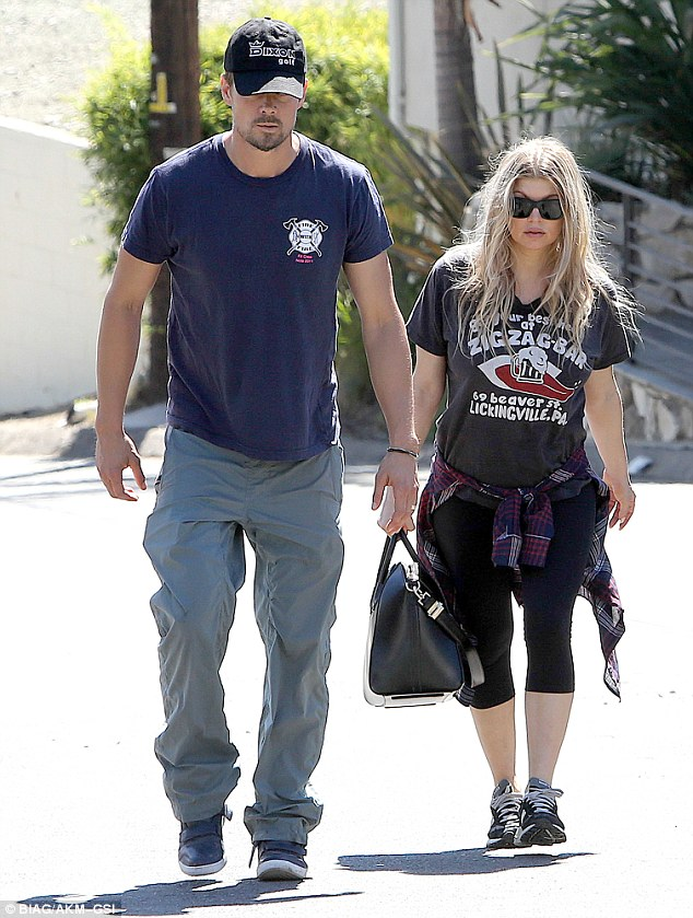 Whoa mama! Fergie displayed her incredible post-baby body in tight leggings as she and husband Josh Duhamel inspected renovations at their home in Brentwood, California on Monday