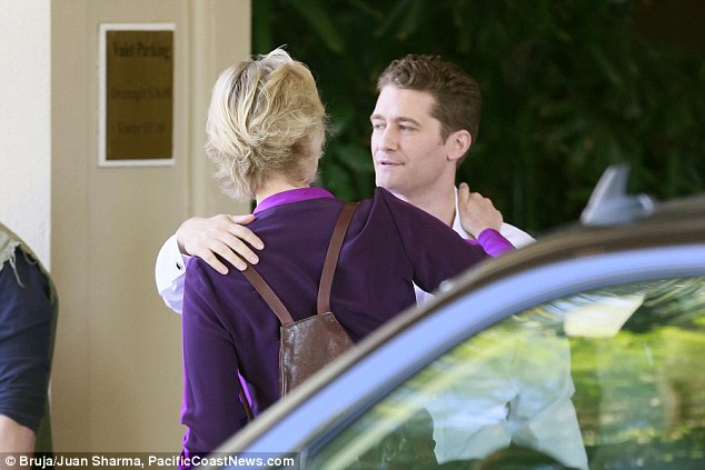 Sharing a moment: The pair stayed close as they chatted together before heading into the hotel
