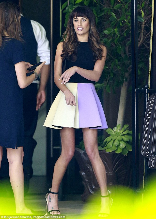 Keeping it together: Lea Michele displayed her slender legs in a flared skirt as she met up with her Glee co-stars on Tuesday in LA ahead of the Cory Monteith tribute episode