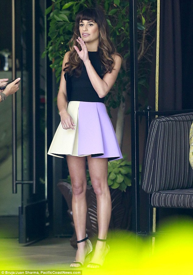 Glam girl: Lea paired the purple-and-cream skirt with a sleeveless black top and strappy black heels as she stood outside of the upmarket hotel