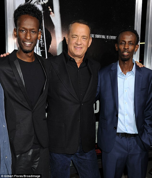 Award-winning performance: Hanks is seen alongside his Captain Phillips co-stars, from  left Faysal Ahmed and right Mahat M. Ali who playSomalian pirates in the new movie