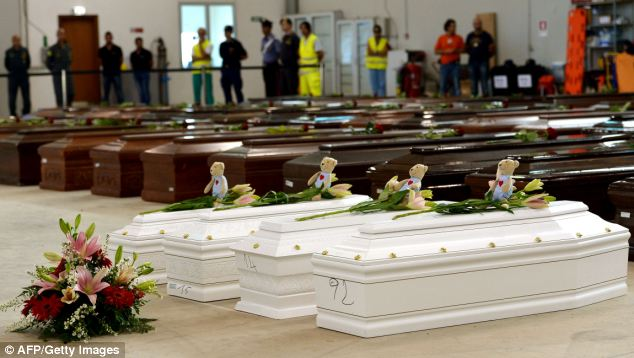 Devastating: Coffins of children are pictured in the Lampedusa airport hanger