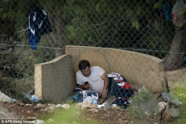 Homeless: A migrant rests inside the Temporary Permanance Centre (CPT), refugee camp, on the island