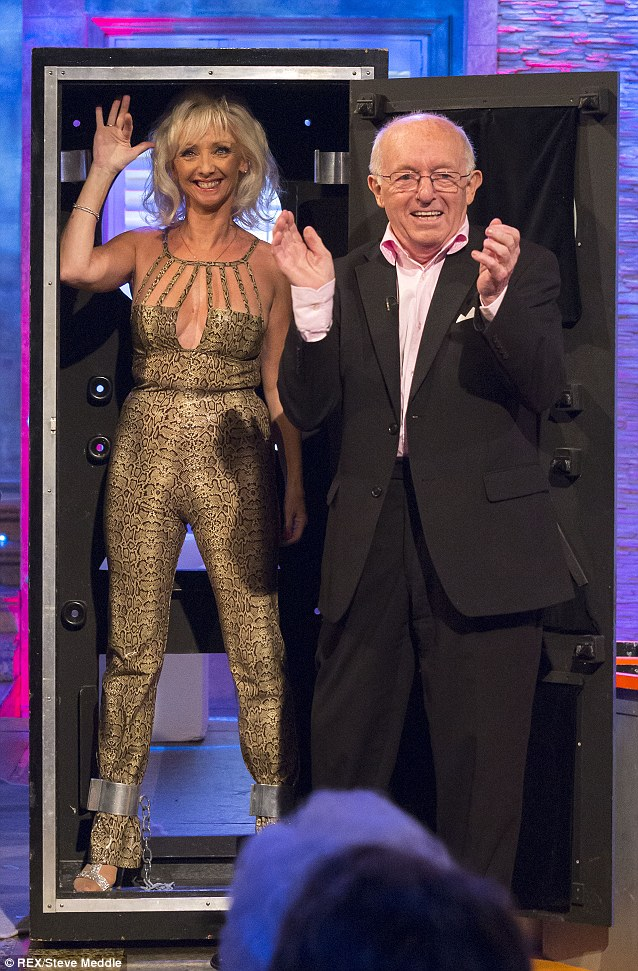 Chained! Debbie reprises her glamorous assistant role for the ITV show