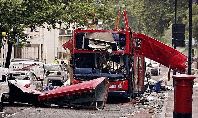 The spy chief said there is a 'growing proportion of groups and individuals taking it upon themselves to commit acts of terrorism'. Pictured is the 7/7 London bombings, which killed 52 civilians