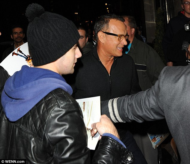 Well wishers: Hanks mobbed by fans as he arrived back at Claridge's Hotel after dining at noodle chain Wagamama's on Tuesday evening