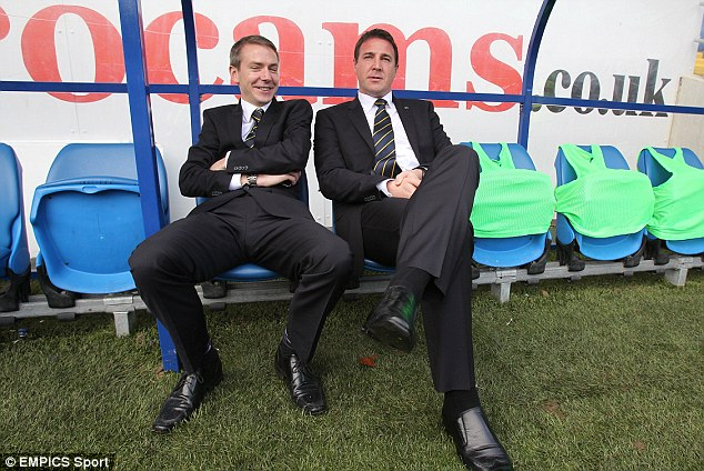 Malky Mackay sits with recruitment director Iain Moody in the dugout