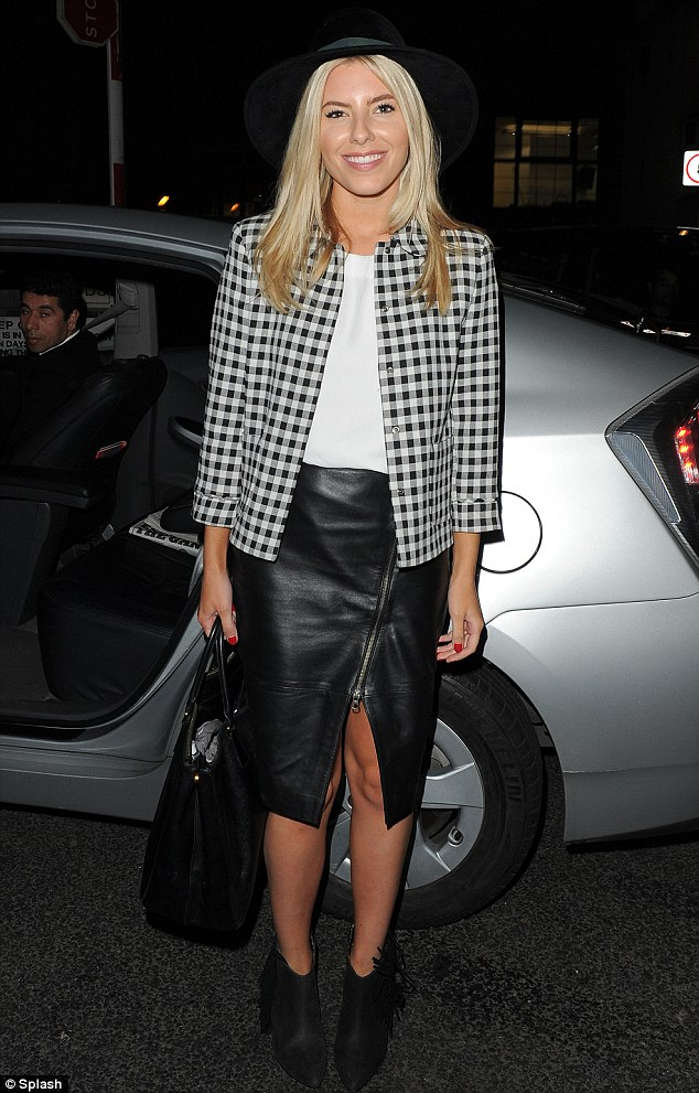 Fun look: Mollie looked great in her leather skirt featuring sexy zip detail with gingham jacket