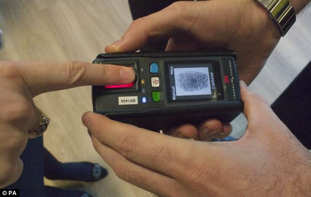New technology: The first police force in Scotland is trialling the use of mobile fingerprint scanners