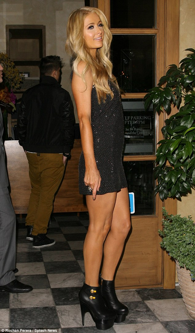 Those shoes weren't made for dancing: Paris tottered her way inside the Rivabella restaurant in West Hollywood in her high heels