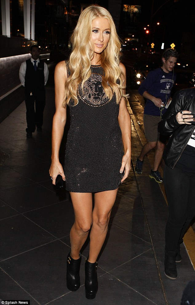 Ready for her big night: Paris Hilton chooses stunning Versace dress and and towering platform boots as she celebrates her new single release