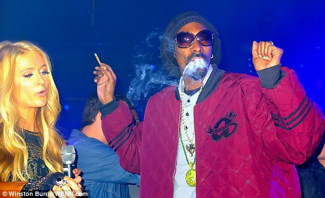 Having fun? Snoop looked like he was loving his night out as Paris concentrated on her Dj-ing