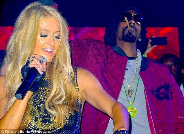 Superstar DJ: Paris took to the decks whilst Snoop smoked a rollup cigarette at the star-studded bash