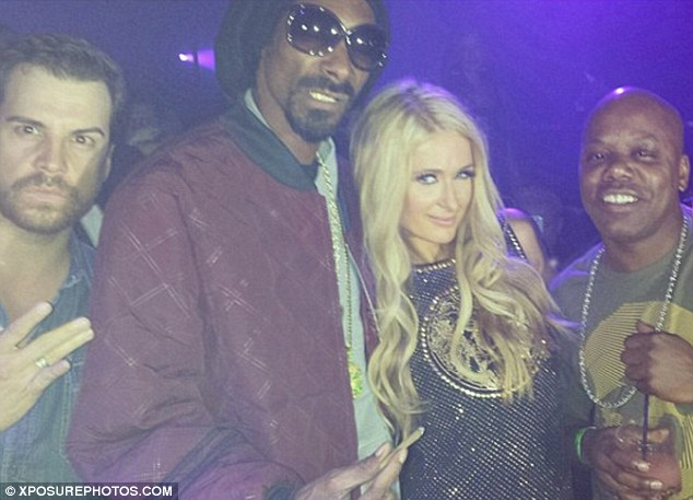 Me and my mates: Paris was joined by Snoop Dogg and Too $hort for her celebratory party