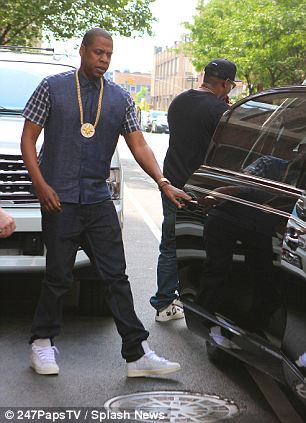 The luxe life: Lil Wayne (left, seen with a diamond-encrusted watch) and Jay Z are both known fans of Maybach cars (seen beside Jay Z at right) which generally cost just under half a million dollars