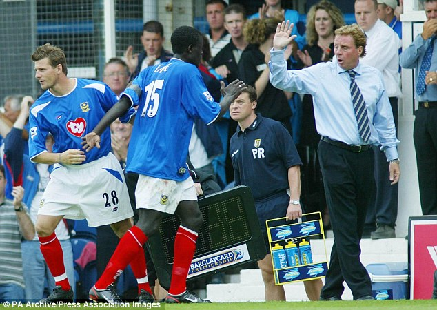 Different class: Harry gives Faye a high five after substituting the Portsmouth midfielder