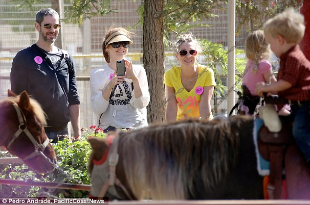 My little pony: Amy and Darren look on as little Aviana enjoys a ride at a pumpkin patch on Friday