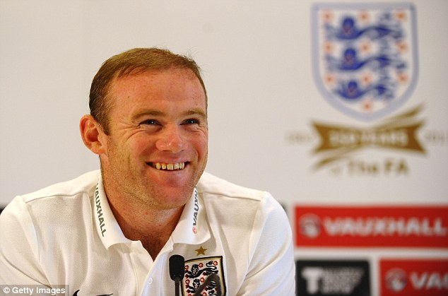 All smiles: Rooney says he's enjoying his football at both club and international level