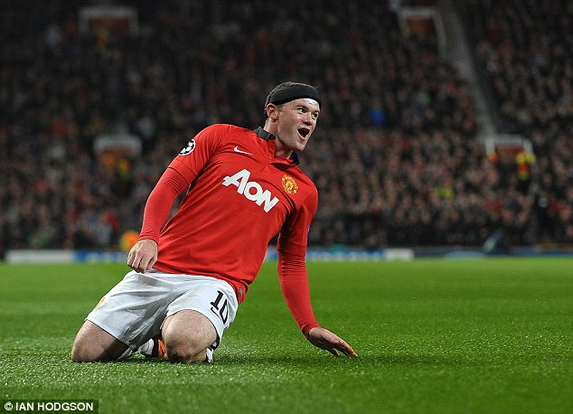 On form: Rooney celebrates scoring in United's 4-2 win against Bayer Leverkusen in the Champions League