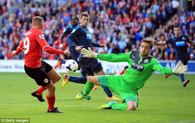 HIT: Newcastle keeper Tim Krul comes out to block the shot of Craig Bellamy at the Cardiff City Stadium