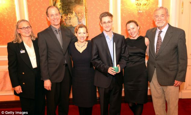 This is the first picture of former NSA analyst Edward Snowden (third from right) since he was given temporary asylum in August.