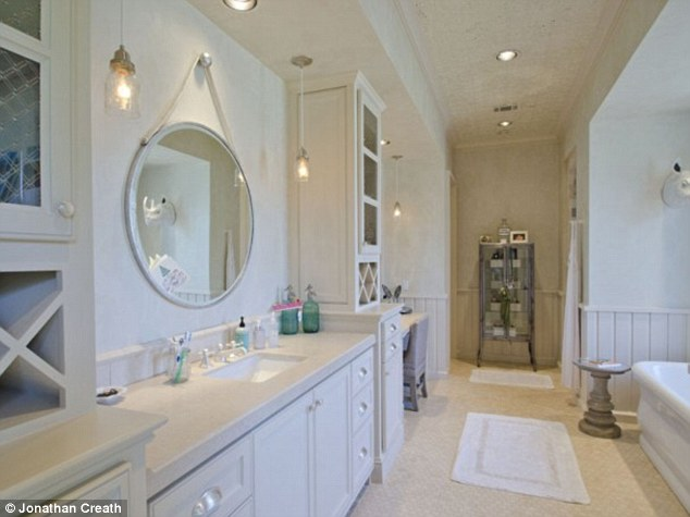 A room of her own: The swimsuit model's private bath features a stand alone tub and a washer and dryer