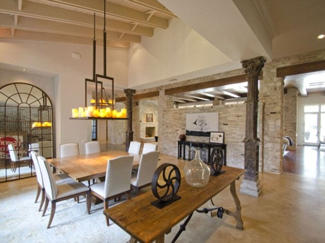 Quite the dining area: Throughout the house are natural touches of exposed stone and wood beams