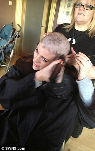 Laura having her head shaved before her treatment. The fashion devotee decided to add a touch of glamour to her ordeal and started an online guide on how to stay beautiful during the treatment