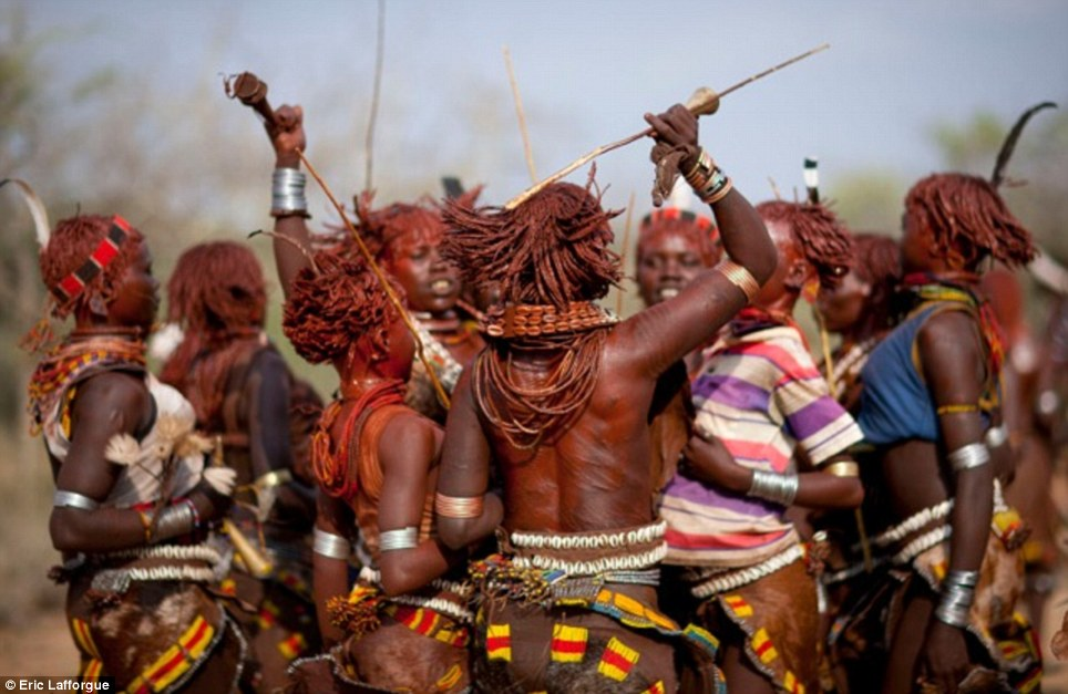 Rite: Hamar women dance themselves into a frenzy as they take part in a colourful ritual