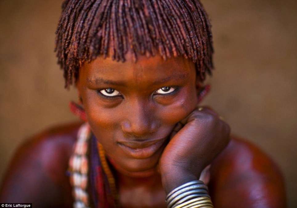 Intricate: A Hamar woman shows of her carefully braided hair and treasure trove of bright beads, shells and metal bangles