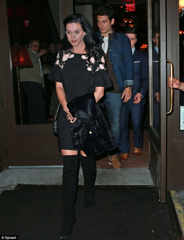 The lady is a vamp: Katy Perry dressed to impress in thigh high boots on a romantic dinner date with her boyfriend John Mayer