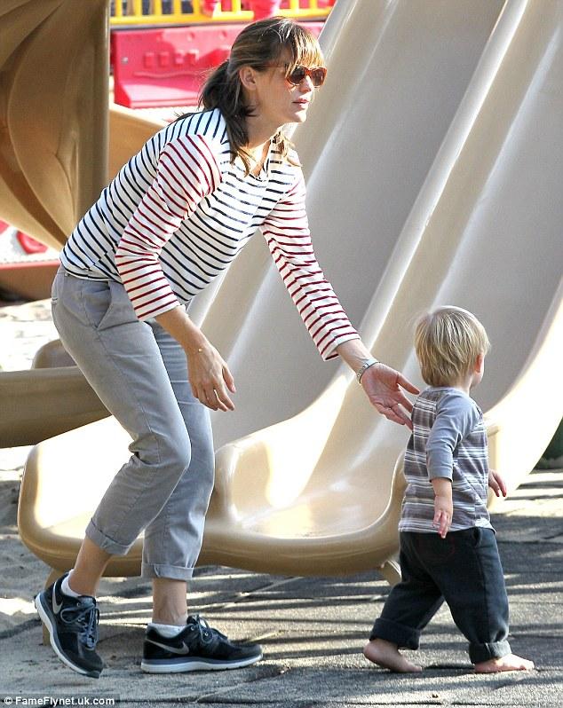 Come here, you: Jennifer keeps a close eye on little Samuel