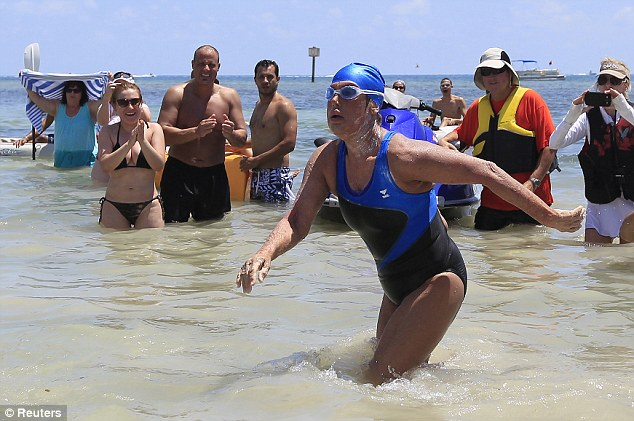 Victorious: Above, Nyad successfully landing in Florida last month after her fifth attempt to swim from Cuba to Florida without a shark tank