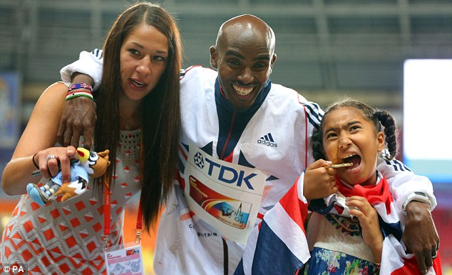 Family support: Mo Farah poses with his wife Tania Farah and daughter Rhianna  Farah, after winning the Men's 5000 metres at this year's World Championships