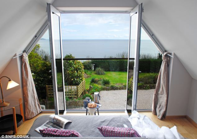 Retreat: Spectacular views from the window of one bolthole - called the Boat house in Downderry, Cornwall