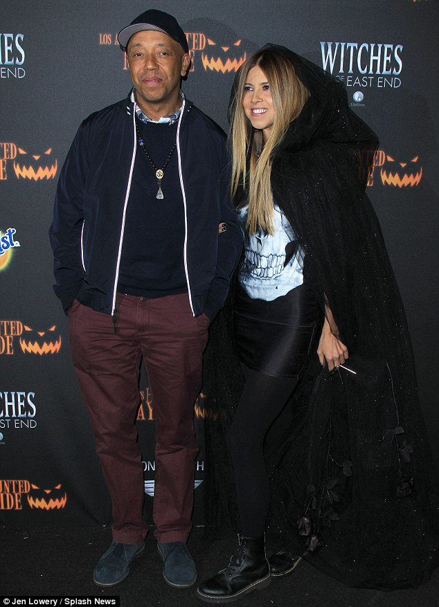 Ready to go: Russell Simmons hid his fear well as he posed with his assistant Simone Reyes